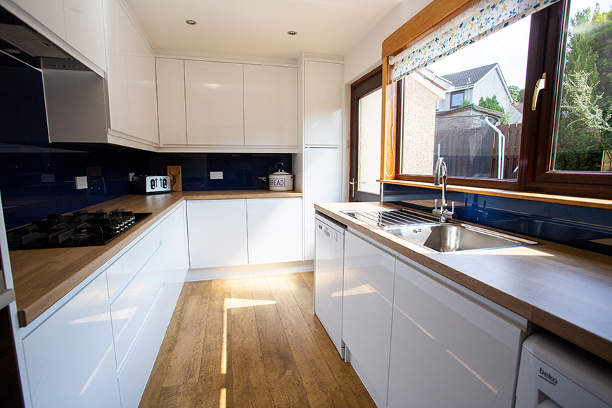 Modern Kitchen with Blue Splashback